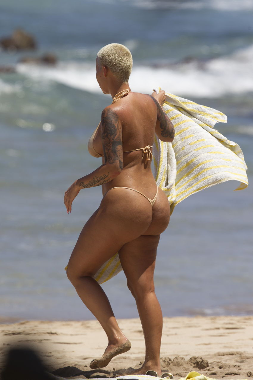 EXCLUSIVE: Amber Rose spotted in a bikini with male friend in Hawaii